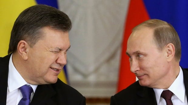 Ukrainian President Viktor Yanukovich, left, gives a wink to his Russian counterpart Vladimir Putin during a signing ceremony after a meeting of the Russian-Ukrainian Interstate Commission at the Kremlin in Moscow on Tuesday. Russia is planning to buy $15 billion worth of Ukraine's upcoming eurobonds using money from a sovereign wealth fund this year and next.