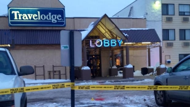Edmonton police investigate a fatal stabbing at the southside Travelodge motel Wednesday morning.