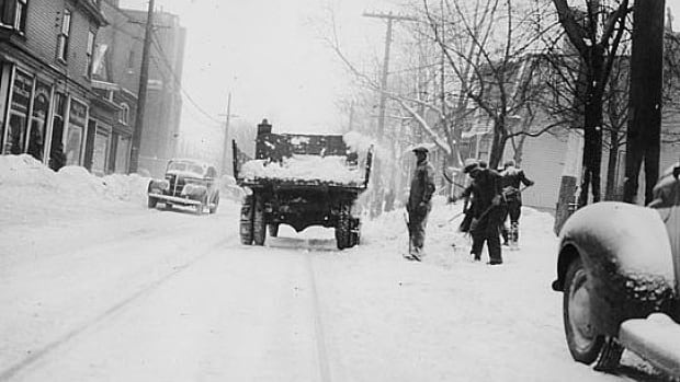 Men shovel along Coburg Road in Halifax in this undated old photo.