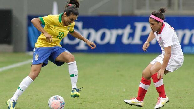 Brazil's Marta Vieira, left, takes control of the ball as Canada's Desiree Scott looks on.