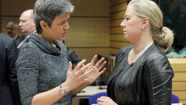 Danish Finance Minister Margrethe Vestager, left, talks with Finnish Finance Minister Jutta Urpilainen, during the EU finance ministers meeting, in Brussels Dec. 18.  The ministers agreed on a new institution to manage banks in trouble.