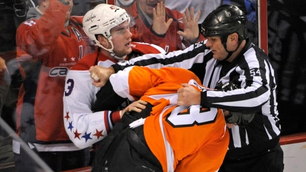 Washington Capitals right wing Tom Wilson (43) fights Philadelphia Flyers defenceman Nicklas Grossmann (8) during the second period Tuesday. Wilson received a game misconduct on preceding the fight for his hit on Flyers forward Brayden Schenn.