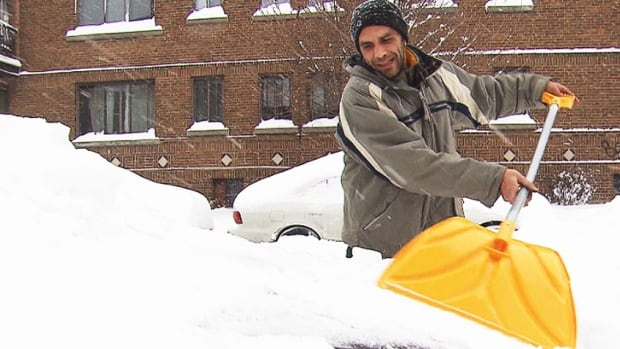 A Montreal man digs out after a winter storm hit that city last year.