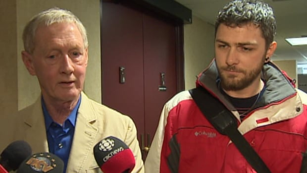 St. John's mayor Dennis O'Keefe and CUPW representative Mike McDonald speak to reporters at St. John's city hall on Friday.