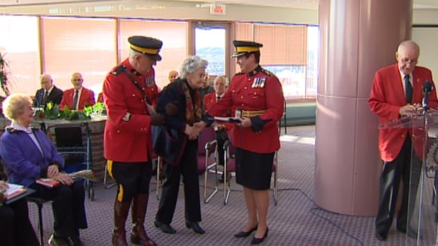 "Ethel Jarvis, 92, is presented with the RCMP ""Second Man"" award in St. John's on Friday. Jarvis was one of 22 women who received the award."