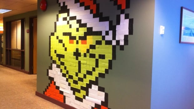 This Post it note Grinch took a team of four people working for six hours to construct.