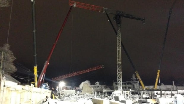 Three cranes are being used to stabilize the existing crane while a fourth crane will be used to lower sections of the damaged crane as it is disassembled.