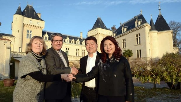 Chinese billionaire Lam Kok and his wife pose alongside the French former owner of the Chateau de La Riviere, James Gregoire, and his wife in front of the castle. Kok, his son and Gregoire were flying over the property when their helicopter crashed into the Dordogne river.