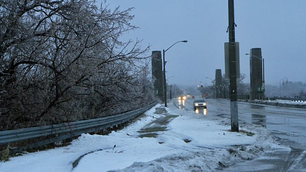 Cars drive along York Boulevard on Sunday morning during this weekend's ice storm.