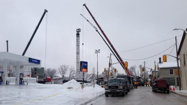 This photo shows the crane in the final stages of dismantling on Saturday, Dec. 21 in Kingston, Ont.