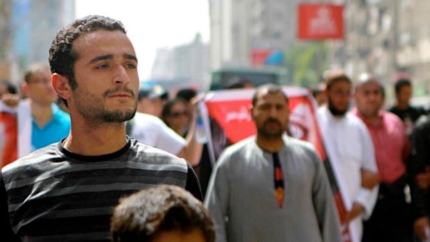 Activist Ahmed Douma, left, shown during a march to Tahrir Square demanding prosecution of members of former President Hosni Mubarak's regime, has been sentenced to three years in jail.
