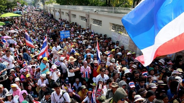 Thai anti-government protesters gather during a rally outside Prime Minister Yingluck Shinawatra's residence on Sunday.  They are calling her to leave ahead of the February elections.