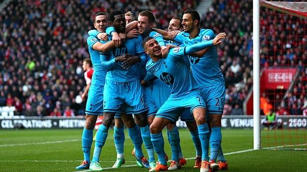 Tottenham players celebrate after a goal against Southampton at St Mary's Stadium on December 22, 2013 in Southampton, England.