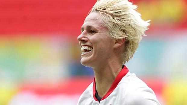 Canada's Sophie Schmidt celebrates after scoring against Scotland at the International Women's Football Tournament in Brasilia, Brazil, Sunday, Dec. 22, 2013.