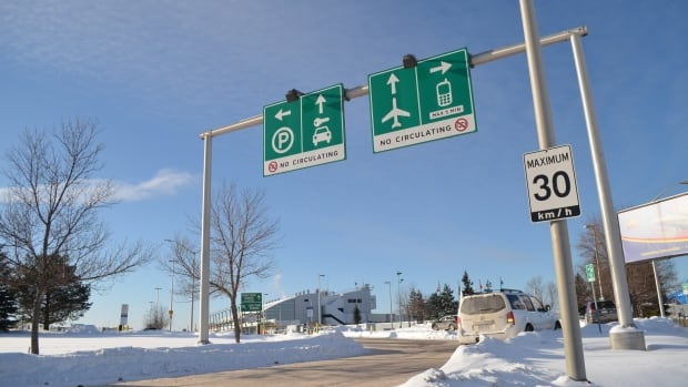 Signs posted at the Thunder Bay airport warn drivers that repeated trips around the parking lot are forbidden.