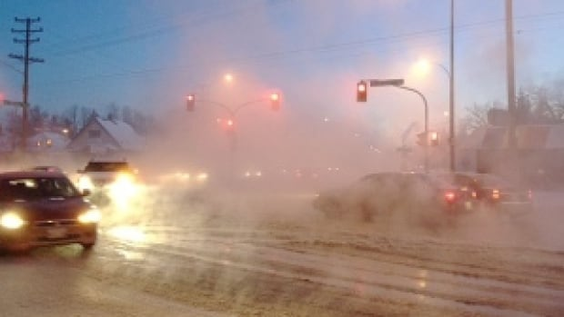 A watermain break created foggy conditions in the brutal cold on Monday morning in Winnipeg at the corner of Fermor Avenue and St. Mary's Road.