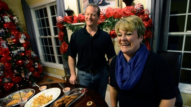 Dr. Jason Cabler, seen at left with his wife Angie, says the stress of running around buying gifts and braving holiday crowds might have been a factor in the heart attack he suffered on Christmas Day in 2012.