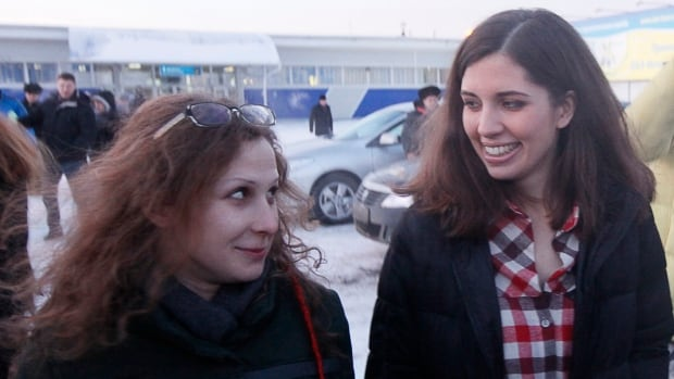 Maria Alyokhina (left) and Nadezhda Tolokonnikova and walk together outside Yemelyanovo airport in Krasnoyarsk, Russia on Tuesday. The two members of Russian punk protest band Pussy Riot were freed from prison on Monday. They derided President Vladimir Putin's amnesty that led to their early release as a propaganda stunt and promised to fight for human rights.