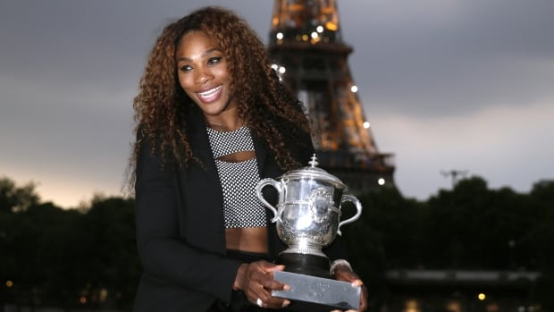 Tennis player Serena Williams poses with the Suzanne Lenglen trophy near the Eiffel Tower in Paris in June after winning the Roland Garros French Tennis Open. On Wednesday, Williams won her third AP female athlete of the year award.