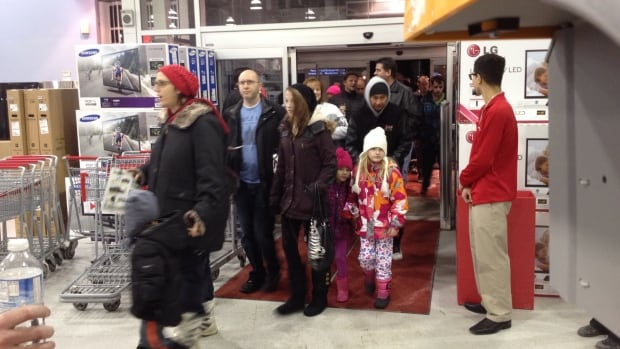 Shoppers flood into the store once the door opened.