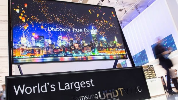 A 110-inch Ultra High Definition 4K television screen is displayed on the Samsung booth at IFA, one of the world's largest trade fairs for consumer electronics in Berlin, Sept. 5, 2013.