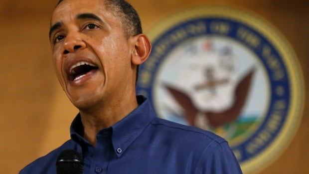 U.S. President Barack Obama speaks to military personnel during a Christmas day visit to Marine Corps Base Hawaii in Kaneohe, Hawaii on Dec. 25, 2013. Obama is on vacation with his family in nearby Kailua.
