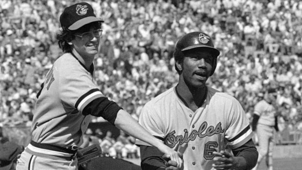 In this Oct. 5, 1974, photo, Baltimore Orioles' Paul Blair, right, is greeted at the plate after a home run in the opening game against the Oakland Athletics in the American League baseball playoffs in Oakland, Calif.