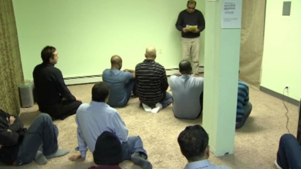 Muhammad Javed addresses Muslims gathered for one o'clock prayers in an office space on Strickland street. In a few years time, Javed says he hopes the community will be able to build a mosque.