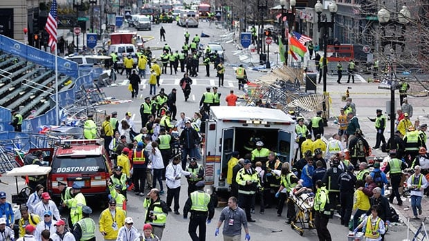 Medical workers aid injured people following an explosion at the finish line of the 2013 Boston Marathon in Boston. The Boston Marathon bombing has been selected the sports story of the year in an annual vote conducted by The Associated Press.