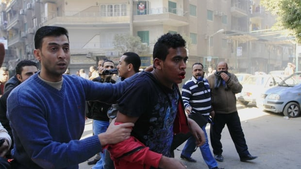 Egyptian security forces fired tear gas and clashed with hundreds of supporters of ousted ex-President Mohammed Morsi.