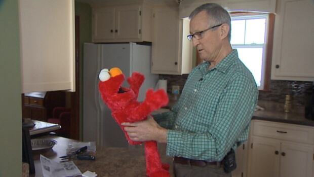 Dave Waterhouse of Bridgewater, N.S., says the batteries of the Big Hugs Elmo toy he purchased became so overheated he worried it would start a fire.