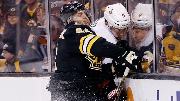 Bruins defenceman Dennis Seidenberg, left, was injured in the third period of Boston's game against the Ottawa Senators on Friday.