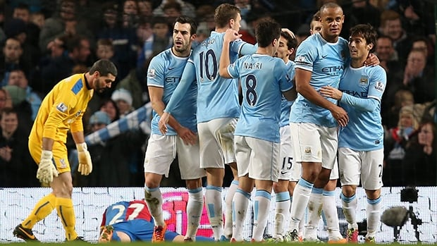Edin Dzeko of Manchester City is congratulated by teammates after scoring the opening goal against Crystal Palace on December 28, 2013 in Manchester, England.