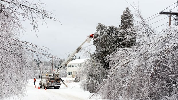 Crews working to restore power in New Brunswick managed to cut the number of customers without electricity to less than 7,000 on Sunday morning. This photo shows work being done on Boxing Day near St. Stephen.