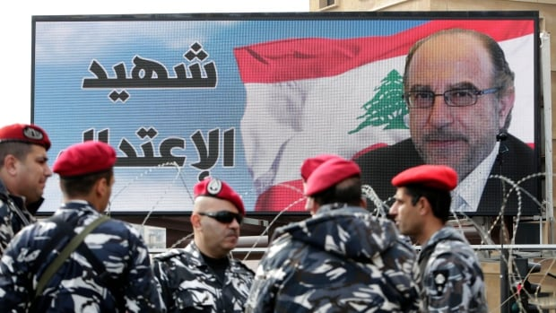 Members of the Lebanese army stand guard by a poster of Mohammed Chatah, who was assassinated on Dec. 27, 2013 by a car bomb. Saudi Arabia has pledged $3 billion to Lebanon to help strengthen Lebanon's tenuous grip on stability and allow the army to purchase weapons from France.