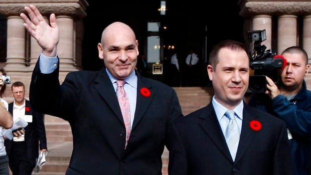 George Smitherman, left, released a statement saying his husband, Christopher Peloso, was found dead by Toronto police.
