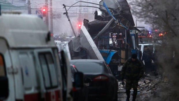 Experts and police officers examine a site of a trolleybus in Volgograd, Russia. The city was the site of two bombings. No one had claimed responsibility until now.