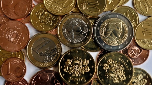 Newly minted Latvian euro coins. Latvia will begin using the euro on Jan. 1, and experts predict that the Baltic country's entry into the currency union will make its large bank sector even more attractive to those who already rely on it to launder suspicious money from less stable former Soviet states like Russia and Kazakhstan.
