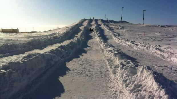 A visitor flies down a hill at the snowtubing hill at Adrenaline Adventures on Monday. The outdoor recreation park has had to close several days in December and January due to extreme cold.