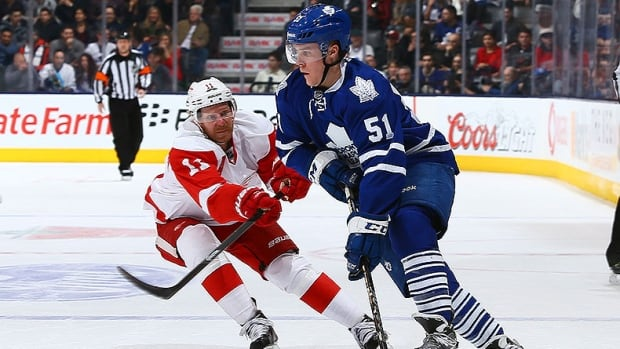 Red Wings forward Daniel Alfredsson, left, attempts to steal the puck from Leafs' defenceman Jake Gardiner, right, in the previous matchup between the two teams on Dec. 21.