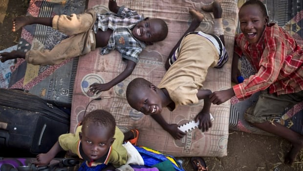 Displaced boys lie on a mattress at a United Nations compound which has become home to thousands of people fleeing violence, in Juba, South Sudan, Dec. 29. Save the Children group says thousands of South Sudanese children who cannot access the Juba camp are alone in the bush, separated from their families.