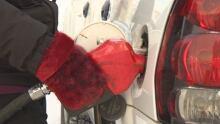 Pumping gas in a sealskin mitt