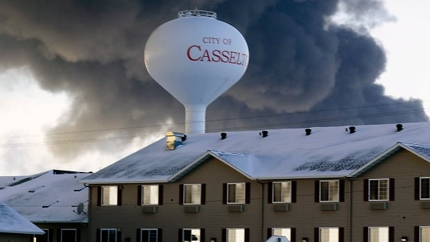 Smoke billows from the site of an oil train derailment Monday in Casselton, N.D. Evacuation orders due to the smoke were lifted Tuesday, as health officials deemed residents safe to return home.