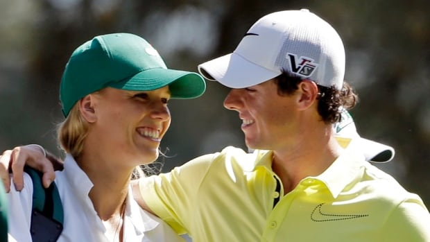 Golfer Rory McIlroy, right, popped the question Tuesday in Sydney, where Caroline Wozniacki is starting to prepare for the Australian Open in Melbourne.