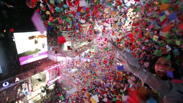 Confetti is dropped on revellers at midnight during New Year's Eve celebrations in Times Square in New York January 1, 2014.