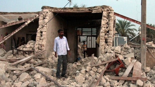 Iran sits on a series of seismic fault lines and experiences one slight quake a day on average, pictured is the ruins of one building from an April 2013 quake.