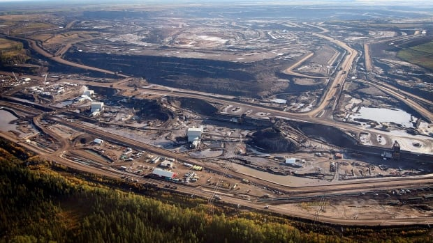 Oilsands mines are shown near near Fort McMurray, Alta. Total is laying off 150 workers after putting its Joslyn Mine on hold.