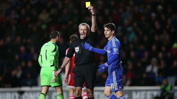 Chelsea midfielder Oscar receives a yellow card for diving during a Premier League match against Southampton.