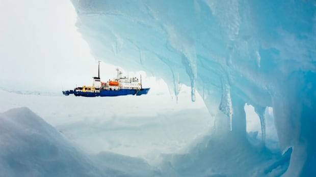"The MV Akademik Shokalskiy is shown trapped off Antarctica. The 52 passengers on the ship were airlifted to safety by a Chinese helicopter on Thursday, but the icebreaker Xue Long, which provided the helicopter, is now stuck as well. The icebreaker with the rescued passengers aboard, Aurora Australis, will now remain on standby in open water in the area ""as a precautionary measure""."