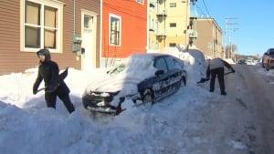 Shovelling snow on Bond St., St. John's, Jan. 2, 2014